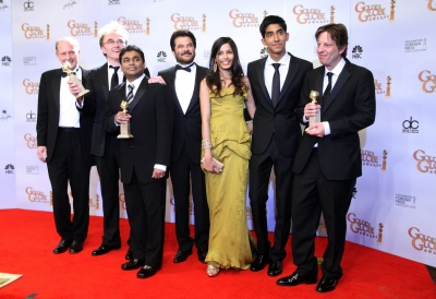 82606_the-cast-and-creators-of-slumdog-millionaire-celebrate-their-golden-globe-for-best-picture-backstage.jpg